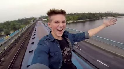 Crazy Kid Rides On The Top Of A Train And Films It
