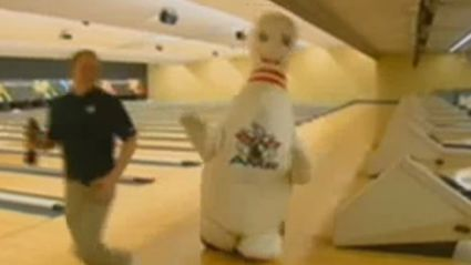 Reporter Attacked By Huge Bowling Pin
