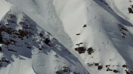 Skier Tries In Vain To Outrun Avalanche