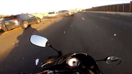 Motorcycle Miraculously Avoids Massive Crash On Motorway