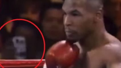The Conspiracy Theory Footage About A Time Traveller Holding A Smart Phone At 1995 Mike Tyson Fight