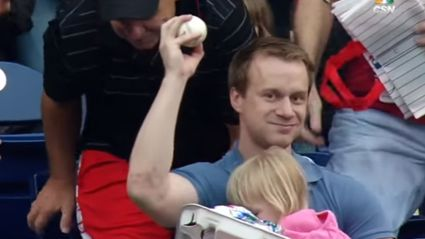 Dad Catch Baseball Foul Ball With One Hand While Holding His Daughter