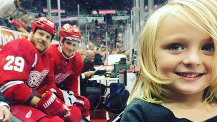 Little Girl's Photo Goes Viral After Being Photobombed By Two NHL Players