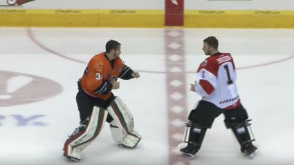 Epic minor league ice hockey goalie fight ends in one punch knockout