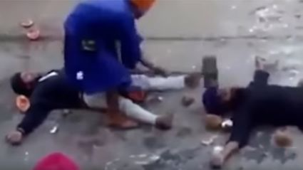 Blindfolded martial arts master smashes volunteer on the head with sledgehammer