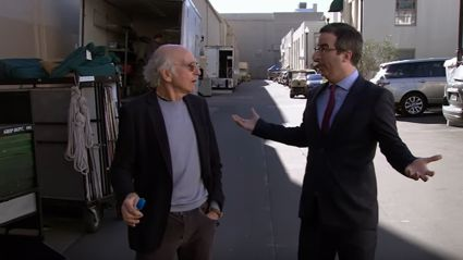 John Oliver argues with Larry David to tease his return