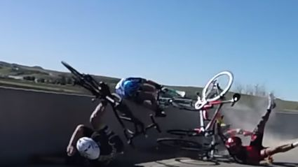 Cyclist miraculously avoids flying off bridge following crash