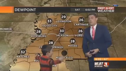 Kid interrupts live weather report and farts on the weather man