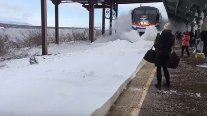 Watch a train blast people with a crap load of snow