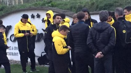 Head coach Thomas Tuchel is surrouned by players after the bus of Borussia Dortmund was damaged. Photo / Carsten Linhoff/dpa via AP/NZ Herald