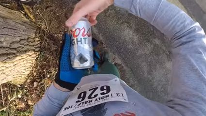 Hero runs Half-Marathon shot-gunning beers every mile