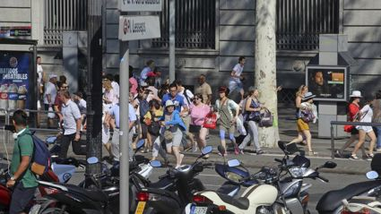 People flee the scene in Barcelona, Spain after a white van jumped the sidewalk in the historic Las Ramblas district. Photo / AP / NZ Herald