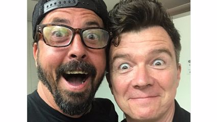 "Watch Foo Fighters troll audience playing ""Never Gonna Give You Up"" with Rick Astley"
