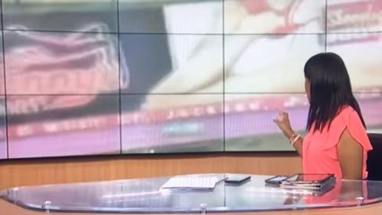 News cameraman gets distracted by strip club sign during live cross