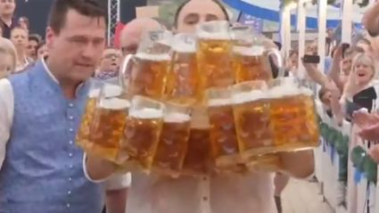 Guy breaks world record by carrying 29 beer steins at once