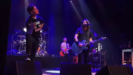 Watch the Foo Fighters play AC/DC with the lead singer of The Hives