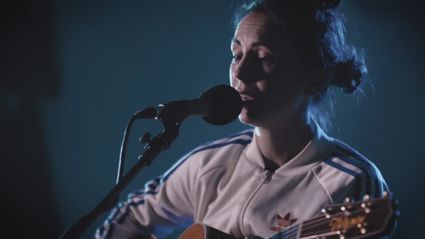 "Watch Amy Shark play ""Adore"" live"