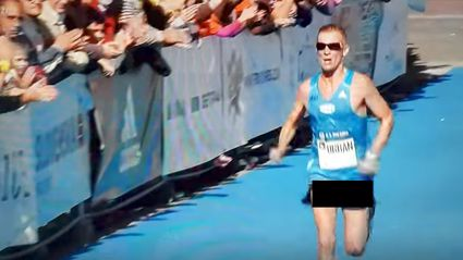 Marathon runner powers to finish line with his c & bs hanging out
