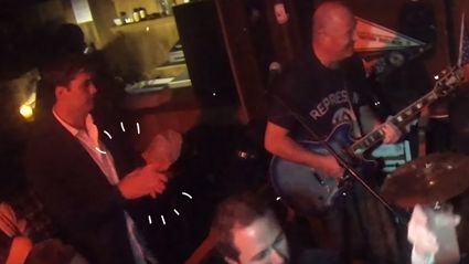 Guy with absolutely no rhythm punishes live band