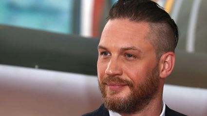 Watch Tom Hardy talk to his dog as Bane