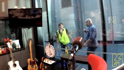 Watch Leigh Hart blow up at a bloke cleaning the studio windows during Amy Shark interview