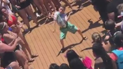 Watch this kid destroy peoples faces during a cruise ship dance-off