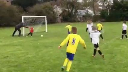 Watch coach/dad push kid to make save