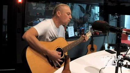 """Watch Neil Fraser perform """"Raised In The Dark"""" live"""